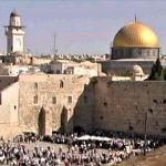 The Temple Mount with the Western Wall and crowds in prayer