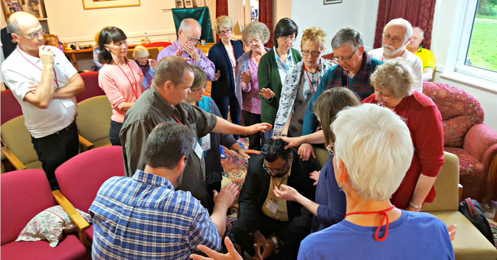 Group prayer at the Discerning the Times Prayer Event in England, May 2017