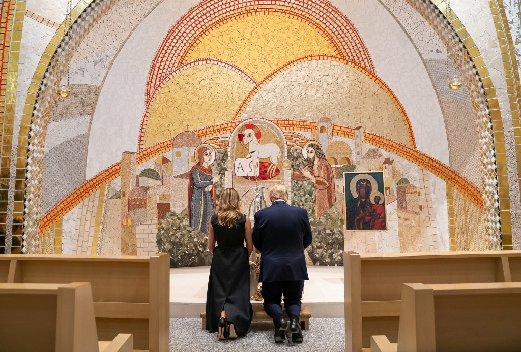 President Trump and First Lady kneeling at the altar in St Paul II chapel.